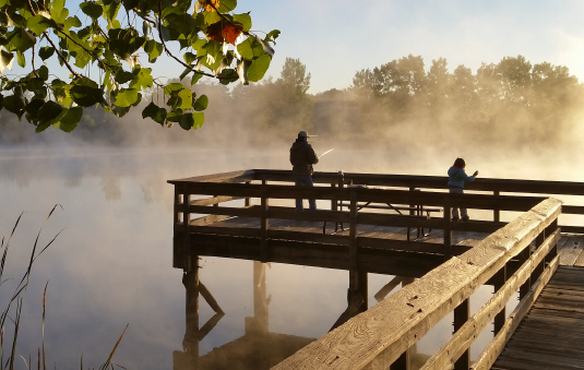 Image of people fishing from dock.